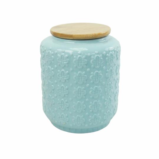 pote de cerâmica azul claro com tampa de madeira